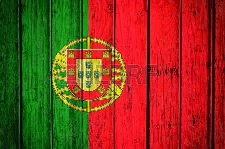 21163596-portugal-flag-on-the-old-wooden-backgroun