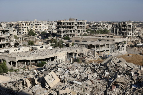 Shelled buildings in the suburbs of Damascus. Bass