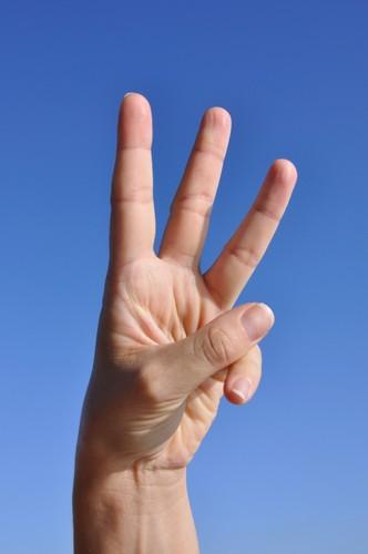 featurepics-woman-hand-three-fingers-094326-130136