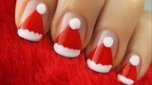 unhas decoradas com gorros de natal.jpg